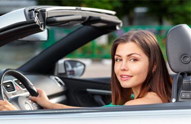 Girl Holding Steering Wheel