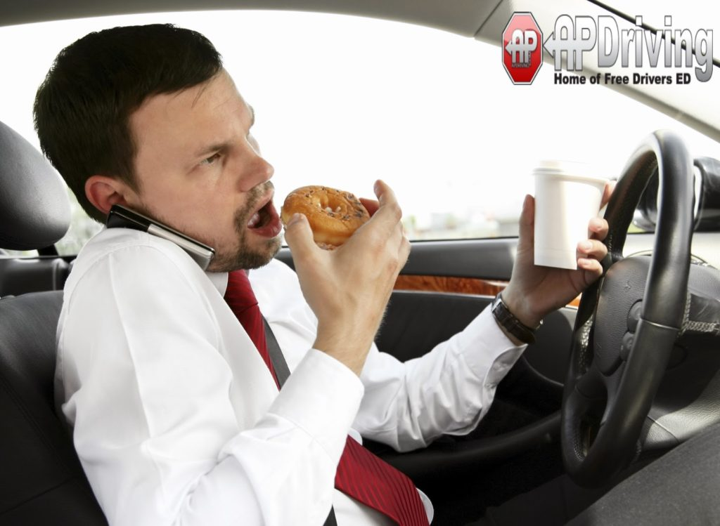 man eating donut driving